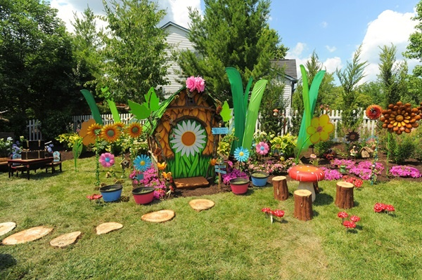 A rusty chain link fence was removed from homeowners Graham and Marcy Galloway's back yard. In it's place popped up a colorful Pixie Hollow inspired play area in one side. As seen on HGTV's My Yard Goes Disney. After #10