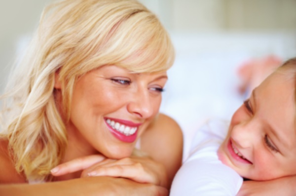 Closeup portrait of a smiling mother and daughter looking at each other