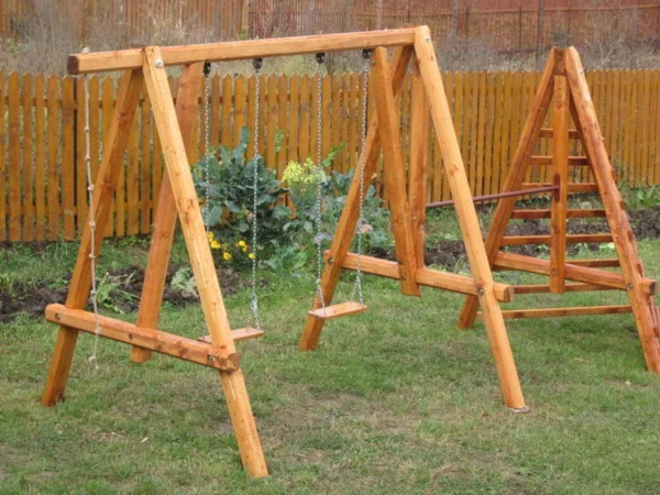 50 impossibly cool swing set ups for your home for Wooden swing set plans