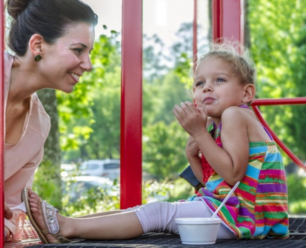 Jenny Champa Muhammad smiles as her daughter, June Muhammad, reacts to the coldness of her ice cream, May 20, 2014, at Frosty Caboose in Chamblee, Georgia. (Photo by Carmen K. Sisson/Cloudybright)
