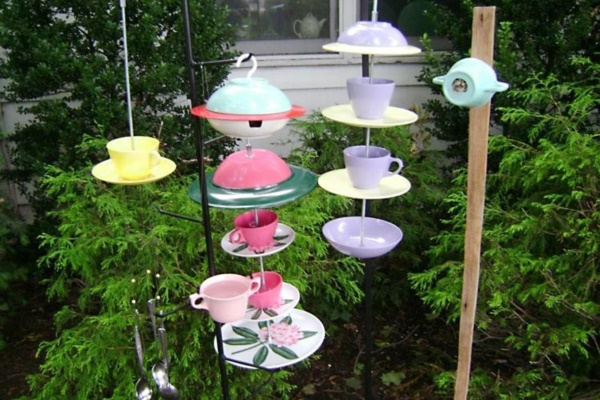 Gerri Kopp uses plastic plates and cups to make wind chimes, bird houses  and birdfeeders.