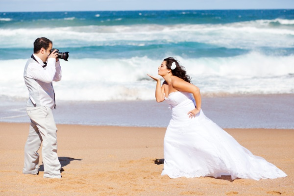 wedding photo shoot - groom taking bride's photo